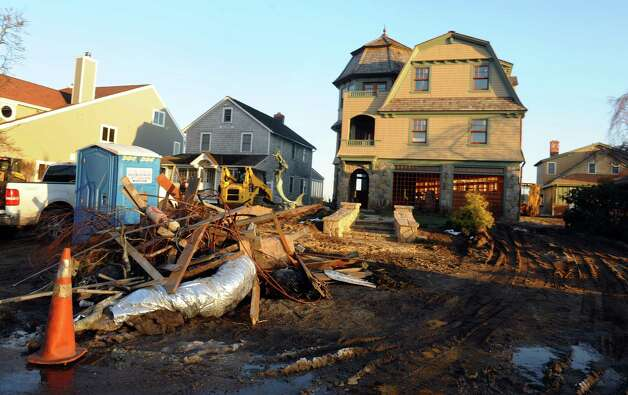 Clean up efforts underway in the aftermath of Hurricane Sandy along Fairfield Beach Road in Fairfield, Conn. on Friday November 9, 2012. Photo: Christian Abraham / Connecticut Post