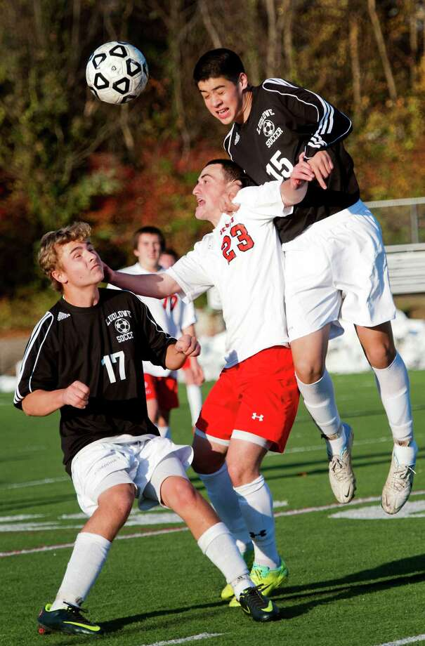 Fairfield Ludlowe high school's Alec Georgiadis and Matthew Doyle battle Fairfield Prep high school's Kieran Bracken for the ball in the first round of the CIAC class LL boys soccer tournament at Alumni field, Fairfield University, Fairfield, CT on Friday November 9th, 2012. Photo: Mark Conrad / Connecticut Post Freelance