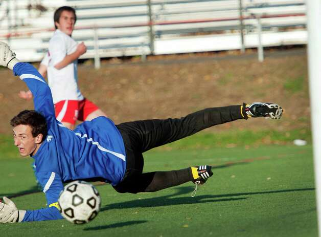 Fairfield Ludlowe high school goalie Ryan Arrigo dives for the ball in front of his goal in the first round of the CIAC class LL boys soccer tournament against Fairfield Prep high school played at Alumni field, Fairfield University, Fairfield, CT on Friday November 9th, 2012. The shot went just wide of the goal. Photo: Mark Conrad / Connecticut Post Freelance