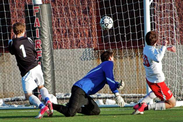 Fairfield Prep high school's Chris Molina scores the only goal of the game, getting his shot by Fairfield Ludlowe high school goalie Ryan Arrigo in the first round of the CIAC class LL boys soccer tournament at Alumni field, Fairfield University, Fairfield, CT on Friday November 9th, 2012. Photo: Mark Conrad / Connecticut Post Freelance