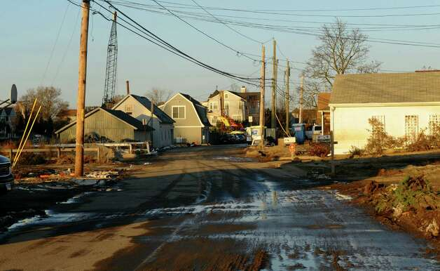 Destruction and clean up efforts in the aftermath of Hurricane Sandy along Fairfield Beach Road in Fairfield, Conn. on Friday November 9, 2012. Photo: Christian Abraham / Connecticut Post