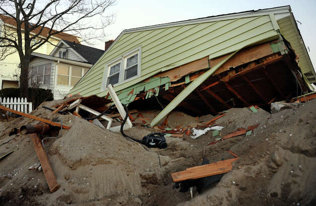 Destruction left behind in the aftermath of Hurricane Sandy along Fairfield Beach Road in Fairfield, Conn. on Friday November 9, 2012. Photo: Christian Abraham / Connecticut Post