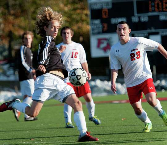 Fairfield Ludlowe high school's Tobias Gimand moves the ball upfield in a first round game of the CIAC class LL boys soccer tournament against Fairfield Prep high school played at Alumni field, Fairfield University, Fairfield, CT on Friday November 9th, 2012. Photo: Mark Conrad / Connecticut Post Freelance