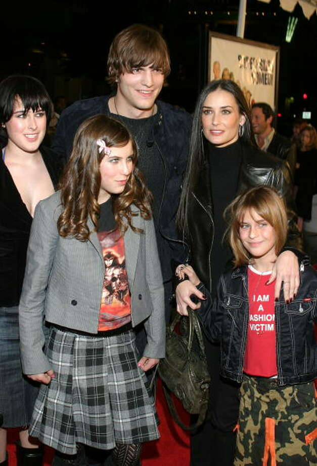 "Moore and Kutcher pose with Moore's offspring Rumer (L), Scout and Tallulah (R) at the 2003 premiere of ""Cheaper by the Dozen.""  Photo: Giulio Marcocchi, Getty Images / 2003 Getty Images"