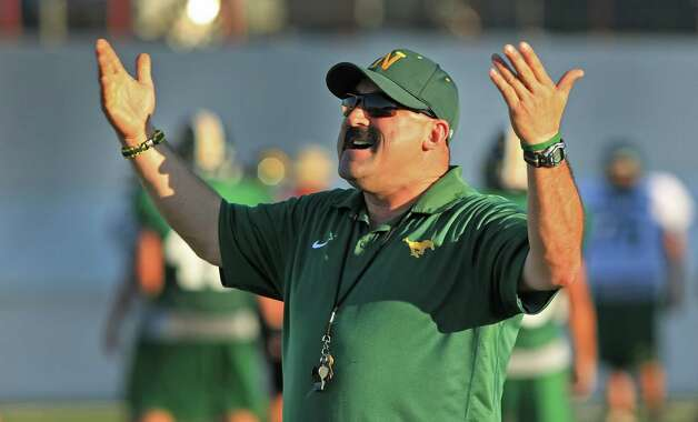 Nixon High School Football Coach Tommy Ramirez encourages his players during a practice at the Laredo school. Thursday. Oct. 4, 2012. Photo: BOB OWEN, San Antonio Express-News / © 2012 San Antonio Express-News