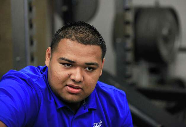 Ricky Flores, a senior on the Cigarroa High School football team in Laredo, crosses the border regularly, to go see family members.  Friday.  Oct. 5, 2012. Photo: BOB OWEN, San Antonio Express-News / © 2012 San Antonio Express-News