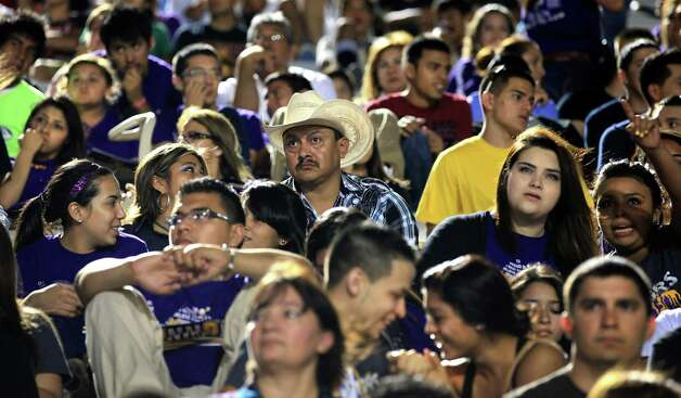 LBJ High School football fans pack the stadium at United Independent School District's Bill Johnson Student Activity Complex in Laredo, as their team plays United High School. Friday.  Oct. 4, 2012. Photo: BOB OWEN, San Antonio Express-News / © 2012 San Antonio Express-News