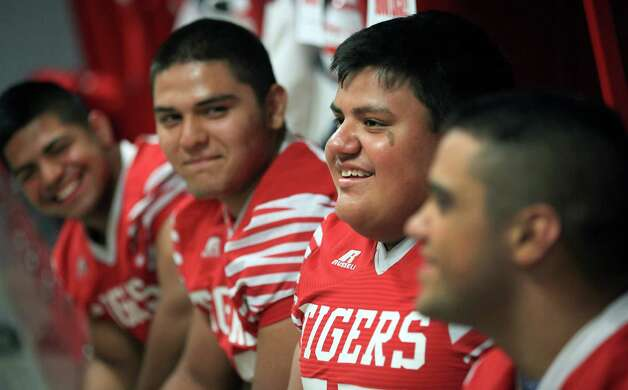Martin High School players Mark Duron, left to right, Edgar Rivera, Eloy Robles Jr., and Rudy Castillo, discuss their experiences living across the river from Nuevo Laredo. Friday, Oct. 5, 2012. Photo: BOB OWEN, San Antonio Express-News / © 2012 San Antonio Express-News