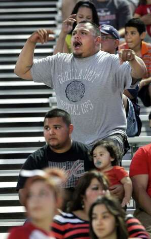 Former Martin High School football player Mark Garcia, cheers for his alma mater, during their game against Corpus Christi Flower Bluff, at Shirley Field in Laredo. Thursday.  Oct. 4, 2012. Photo: BOB OWEN, San Antonio Express-News / © 2012 San Antonio Express-News