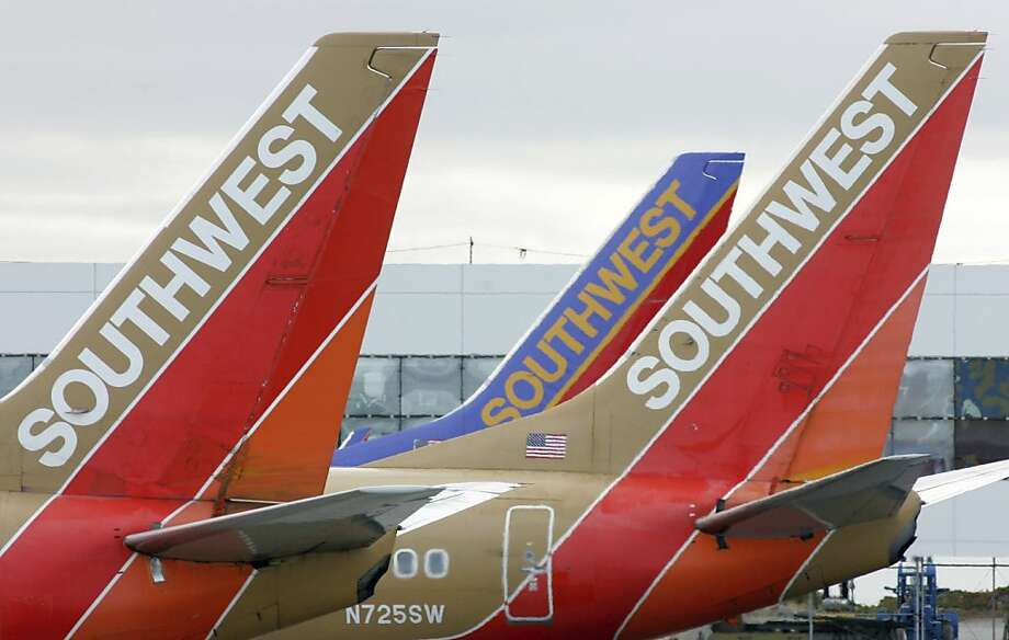 Southwest Airlines no longer requires customers who show up without having reserved an extra seat to pay for one if staff determines it is needed. Photo: John Gress, Reuters