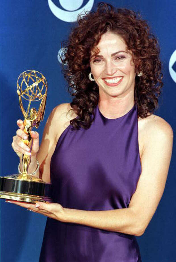 "Kim Delaney is another actress who's 50 this year, but she'll take 50 on Nov. 29. She's pictured in 1997, after winning an Emmy for ""NYPD Blue.""  Photo: KIM KULISH, Getty Images / AFP"