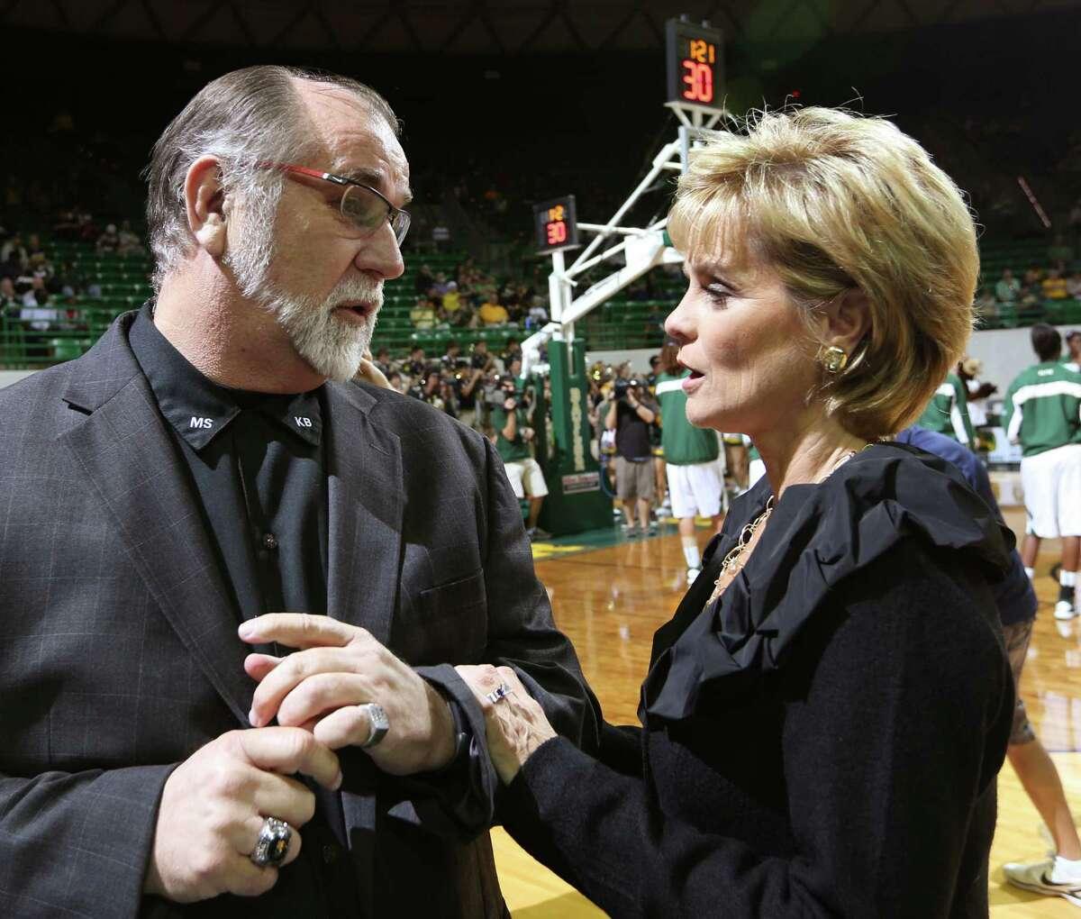 Lamar coach Larry Tidwell, left, visits with Baylor coach Kim Mulkey before an NCAA college basketball game, Friday, Nov. 9, 2012, in Waco, Texas. (AP Photo/Waco Tribune Herald, Rod Aydelotte)