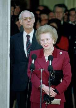 FILE This Wednesday, Nov. 28, 1990 file photo shows Margaret Thatcher making a statement to reporters as she leaves No. 10 Downing Street, Westminster on  for Buckingham Palace where she will resign as Prime Minister to Queen Elizabeth II. It seems a strange sight: The president of the United States, sometimes called the most powerful person in the world, breaking down in tears thanking campaign workers for their tireless _ and ultimately successful _ work on his behalf. But Barack Obama isn't the only world leader unashamed or unable to avoid being seen crying in public. The enduring image of Margaret Thatcher's departure from office is the tearful face captured by photographers in 1990 as she left the prime minister's official residence at 10 Downing Street for the last time after 11 years as prime minister.(AP Photo/Martin Cleaver) Photo: Martin Cleaver, STF / AP