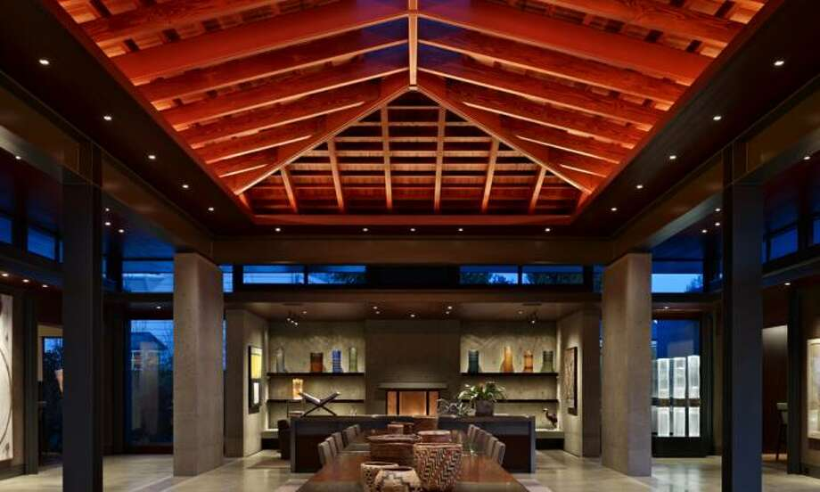 """The International Interior Design Association Northern Pacific Chapter  recently hosted its 2012 INawards ceremony, honoring the best in  Northwest design. Here are the winners, starting with Design in Home winner Lake Washington Shores, Garret Cord Werner, LLC. """"The dramatic center pavilion is the focus of the architecture, displaying a grand 35-foot-long dining table that floats on two pedestals. The table was engineered and constructed out of reclaimed mahogany wood and nickel plated steel sections and may be disassembled to provide a flexible party space. These natural materials were used throughout the whole house to create a unified atmosphere with an elegant yet comfortable finish. Flanking the center pavilion is a floating living room over a reflecting pond and a media room family area at the opposite end with kitchen and bar. The master bathroom features a custom design sunken Japanese bath and frameless window that creates a private garden oasis. In the end, the home merges the exterior and interior spaces to provide a seamless environment with the northwest landscape sticking within the clients' $500,000 budget."""" Photo: Benjamin Benschneider"""