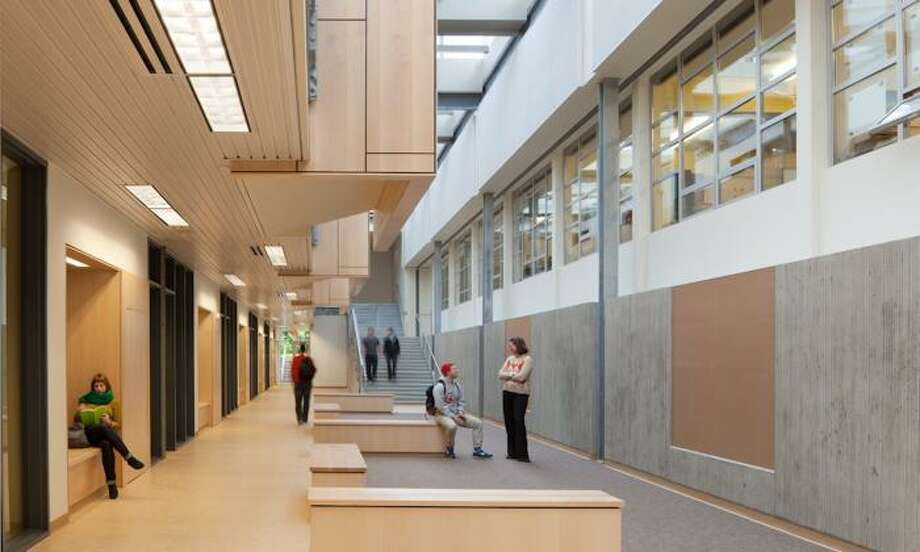 Design in Public winner:Ingraham High School, Integrus Architecture. This new classroom wing addition turned an existing courtyard into an interior space with skylights, added a new plaza, used interior windows to share light and create visual continuity between classrooms and corridors and included an open staircase with a tiered seating area, creating a forum-like space. Photo: Lara Swimmer