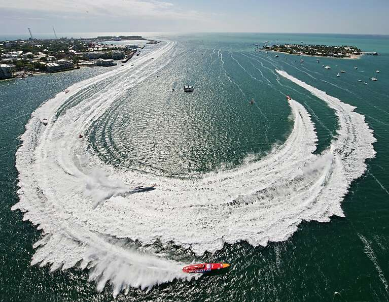 Superboat Extreme offshore raceboats make the turn in Key West Harbor, Friday, Nov. 9, 2012, during