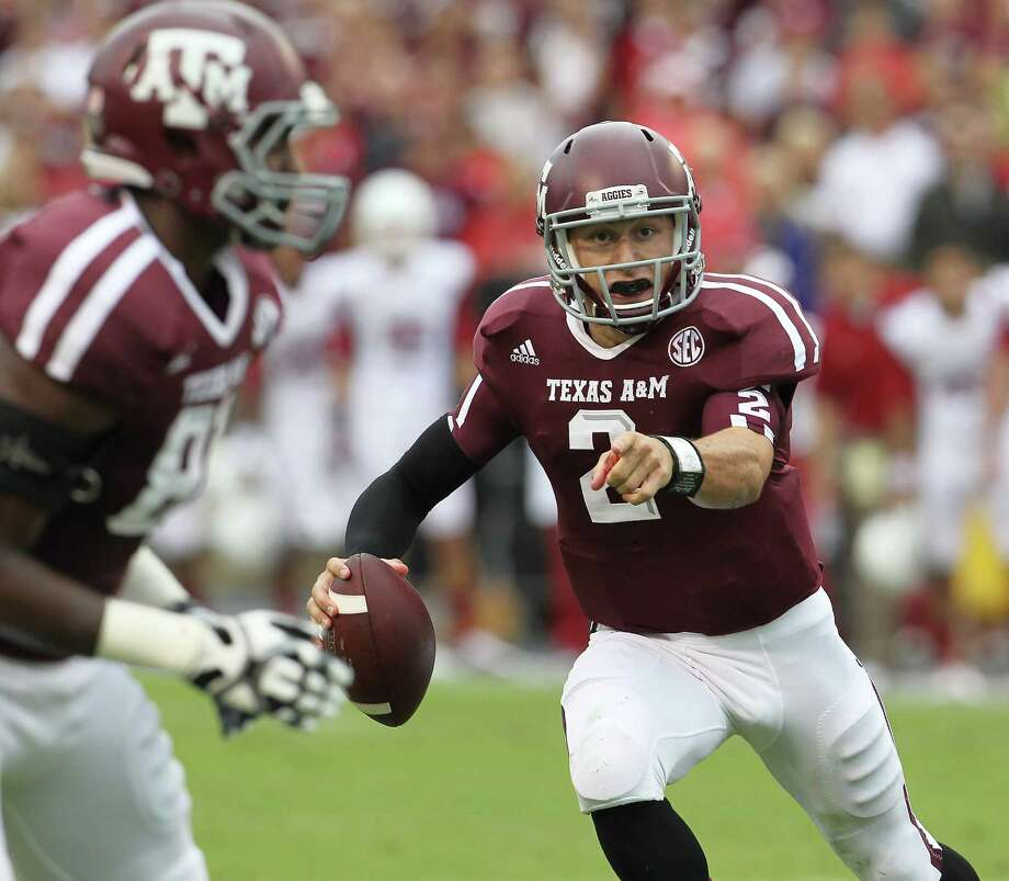 Texas A&M quarterback Johnny Manziel (2) scrambles during the first quarter of a college football game at Kyle Field, Saturday, Sept. 29, 2012, in College Station. Photo: Karen Warren, Houston Chronicle / © 2012  Houston Chronicle