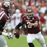 Texas A&M quarterback Johnny Manziel (2) scrambles during the first quarter of a college football game at Kyle Field, Saturday, Sept. 29, 2012, in College Station.