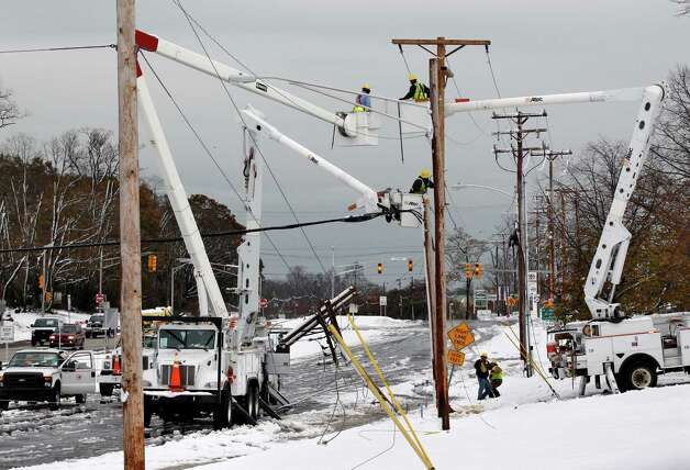 Crews work to repair downed wires Thursday, Nov. 8, 2012, in Eatontown, N.J., after a nor'easter brought high winds and dumped as much as a foot of snow overnight in the region pounded by Superstorm Sandy last week. (AP Photo) Photo: Mel Evans, Associated Press / AP