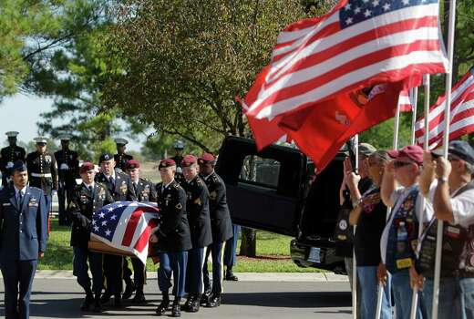 Friday's funeral for Army Staff Sgt. Kashif M. Memon at Houston National Cemetery included a Marine Corps honor guard, rear. Photo: Melissa Phillip, Staff / © 2012 Houston Chronicle