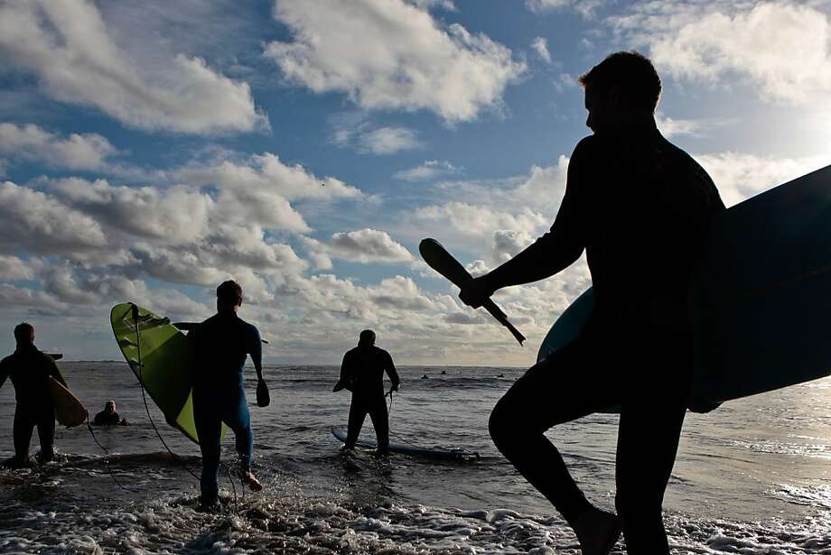 Surfers head out at Mavericks in November at a ceremony to open the competition window. Photo: John Storey, Special To The Chronicle