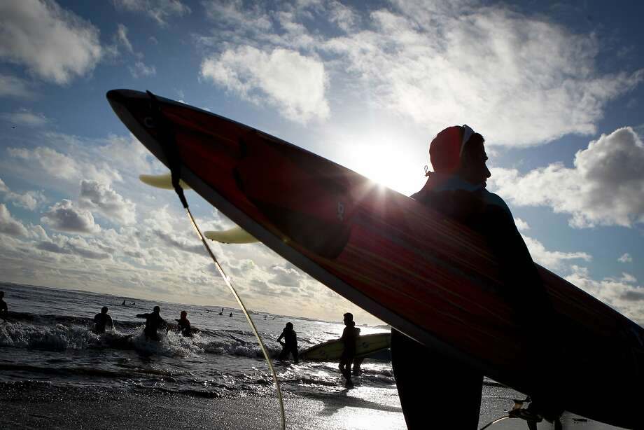 Surfers make their way into the ocean for the opening ceremony of the Mavericks Invitational. Now all the competition north of Half Moon Bay needs is a little cooperation from the waves. Photo: John Storey, Special To The Chronicle