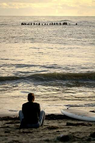 A woman watches from Mavericks Beach during the opening ceremony for the Mavericks Surf Contest in Princeton by the Sea, Calif., on Friday, November 9th, 2012 Photo: John Storey, Special To The Chronicle