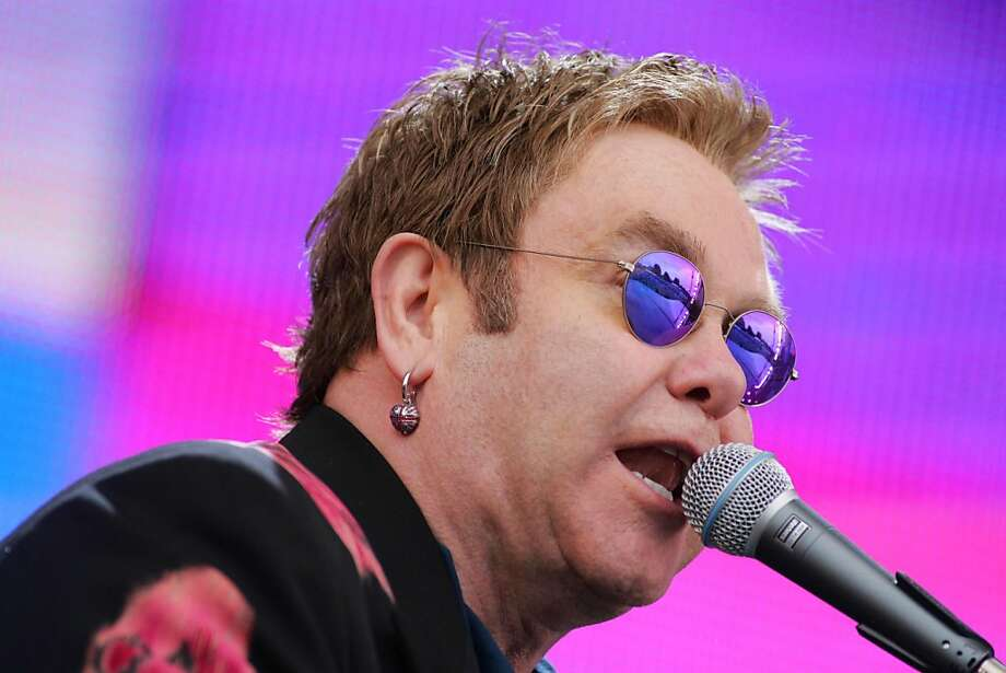 (FILES) - A picture dated July 2, 2005 shows Sir Elton John performing during the Live8 concert in Hyde Park, London. Elton John leads in the list of 123 songs that have sold a million copies in Britain, which was released on November 5, 2012 by the Official Charts Company to mark 60 years of ranking the best-selling singles. AFP PHOTO/JOHN D MCHUGHJOHN D MCHUGH/AFP/Getty Images Photo: John D Mchugh, AFP/Getty Images