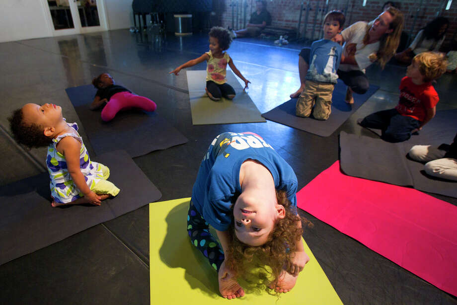 Zoe Park, 5, does Camel, a heart-opening pose, during HopeStone Kids' Yoga Friday, Nov. 9, 2012, in Houston. Photo: Cody Duty, Houston Chronicle / © 2012 Houston Chronicle