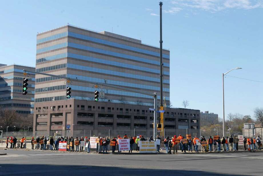 Members of the Connecticut Laborer's District Council protest across from the Government Center on Friday November 9, 2012 in front of the old Advocate building in Stamford, Conn. where Baker Concrete is working. Photo: Dru Nadler / Stamford Advocate Freelance