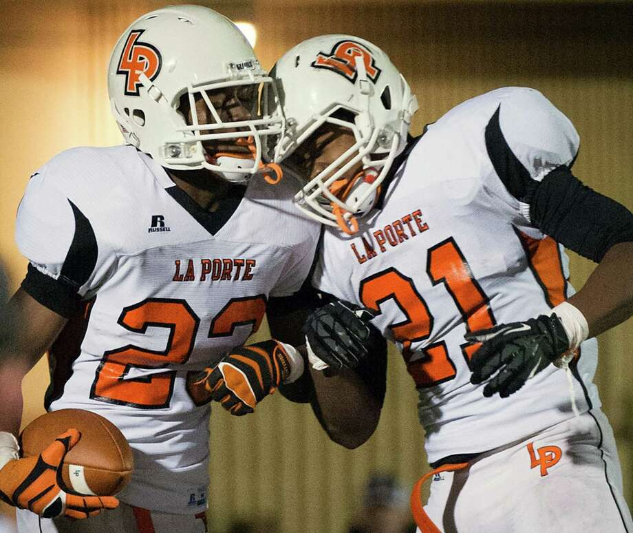 La Porte running backs Johnathan Lewis (23) celebrates with Keith Whitely (21) after Lewis scored a 66-yard touchdown run during the second quarter of a high school football game against Port Arthur Memorial at Memorial Stadium, Friday, Nov. 9, 2012, in Port Arthur. Photo: Smiley N. Pool, Houston Chronicle / © 2012  Houston Chronicle