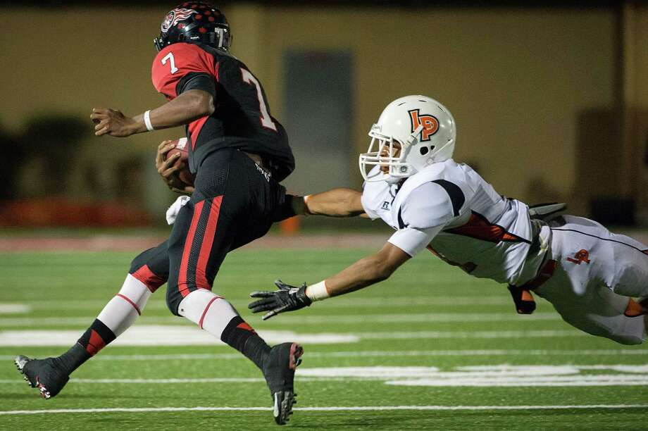 La Porte defensive back Victor Holmes (1) dives for Port Arthur Memorial quarterback Ricky Fisk (7) during the first quarter of a high school football game at Memorial Stadium, Friday, Nov. 9, 2012, in Port Arthur. Photo: Smiley N. Pool, Houston Chronicle / © 2012  Houston Chronicle