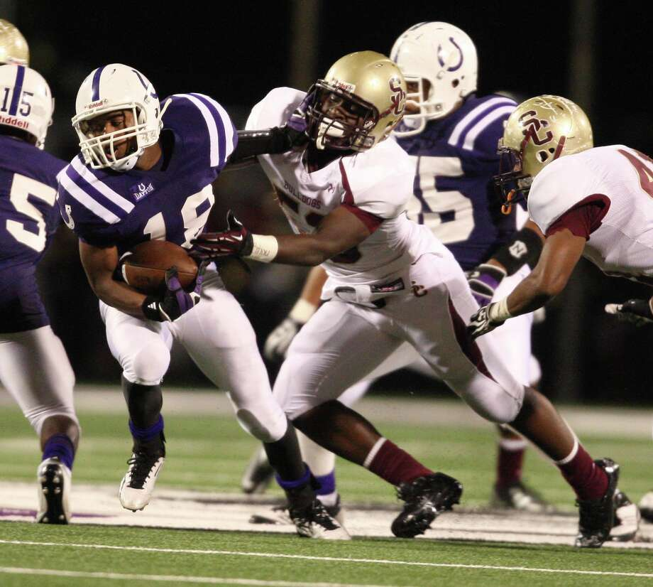 Dayton's Kyle McBride (18) is tackled for a loss by Summer Creek's Josh Williams (53) during the first half of a high school football game, Friday, November 9, 2012 in Dayton TX. Photo: Eric Christian Smith, For The Chronicle