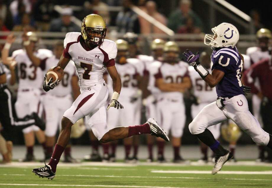 Summer Creek's Gregory Hogan (7) looks back at Dayton's Kyle McBride (18) after a reception during the first half of a high school football game, Friday, November 9, 2012 in Dayton TX. Photo: Eric Christian Smith, For The Chronicle
