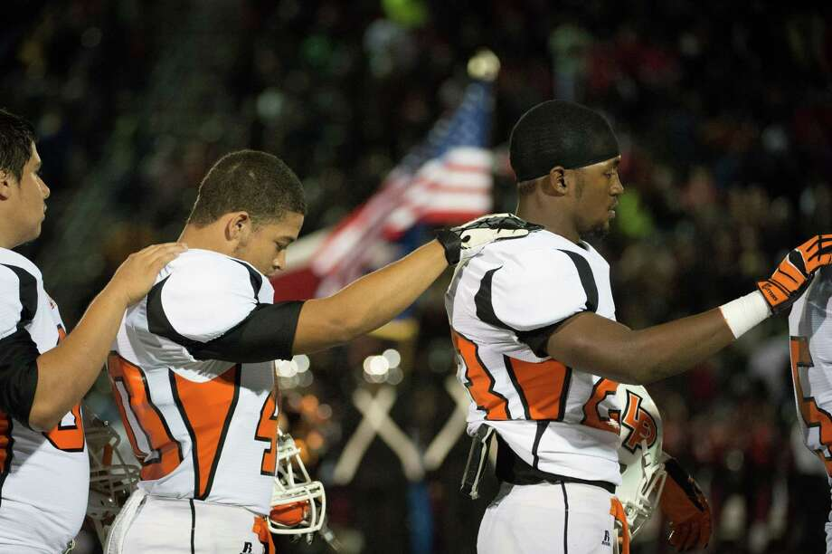 La Porte running back Johnathan Lewis (23) and defensive end Lane Albertson (40) stand for the national anthem before facing Port Arthur Memorial in a high school football game at Memorial Stadium, Friday, Nov. 9, 2012, in Port Arthur. Photo: Smiley N. Pool, Houston Chronicle / © 2012  Houston Chronicle