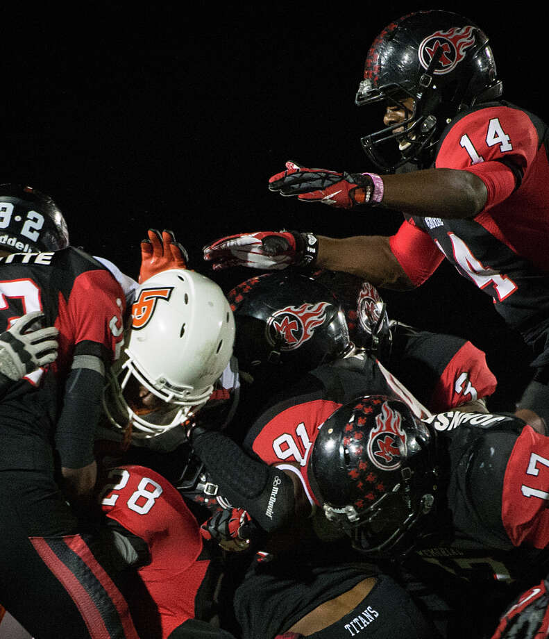 La Porte running back Johnathan Lewis disappears into a swarm of Port Arthur Memorial defenders during the first quarter of a high school football game at Memorial Stadium, Friday, Nov. 9, 2012, in Port Arthur. Photo: Smiley N. Pool, Houston Chronicle / © 2012  Houston Chronicle