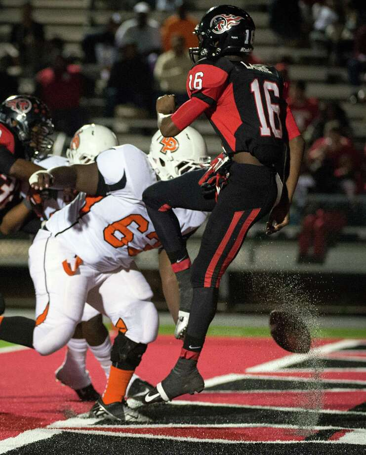 La Porte defensive lineman Corey Lee (63) blocks a punt by Port Arthur Memorial's Tayylor Labrie (16) in the end zone for a safety during the first quarter of a high school football game at Memorial Stadium, Friday, Nov. 9, 2012, in Port Arthur. Photo: Smiley N. Pool, Houston Chronicle / © 2012  Houston Chronicle