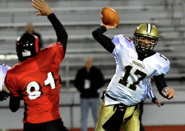 Trumbull QB Nick Roberts passes the ball, during boys football action against Central in Bridgeport, Conn. on Friday November 9, 2012. Photo: Christian Abraham / Connecticut Post