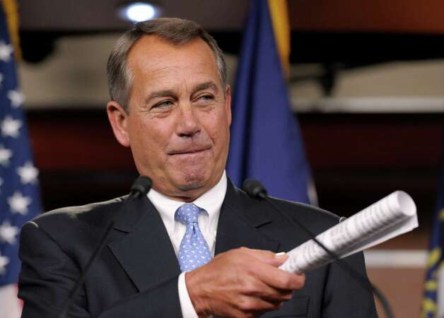 House Speaker John Boehner of Ohio gestures as he speaks to reporters during a news conference on Capitol Hill in Washington, Friday, Nov. 9, 2012. Boehner said any deal to avert the so-called fiscal cliff should include lower tax rates, eliminating special interest loopholes and revising the tax code.  (AP Photo/Susan Walsh) Photo: Susan Walsh