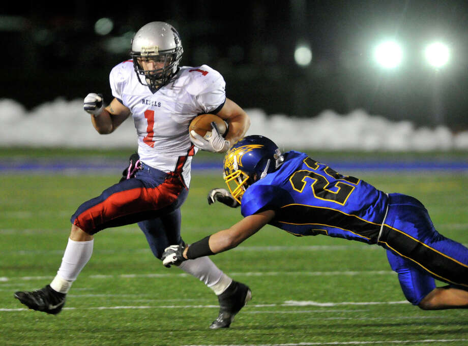 New Fairfield's Joe Pacheco evades Brookfield's Liam Clancy during their game at Brookfield High School on Friday, Nov. 9, 2012. New Fairfield won, 34-19. Photo: Jason Rearick / The News-Times