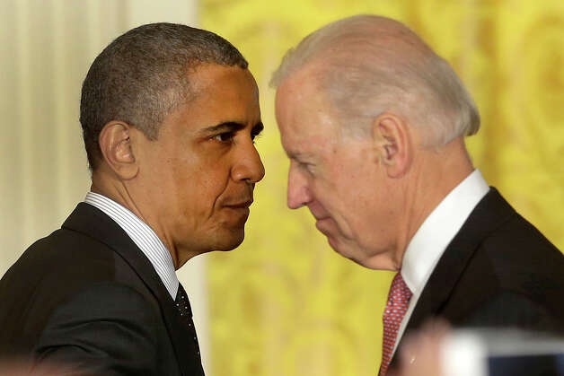 President Barack Obama passes Vice President Joe Biden after speaking on the economy and the deficit, Friday, Nov. 9, 2012, in the East Room of the White House in Washington. (AP Photo/Pablo Martinez Monsivais) Photo: Pablo Martinez Monsivais