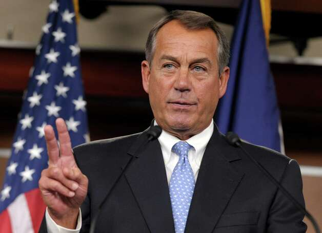 House Speaker John Boehner of Ohio calls on a reporter during a news conference on Capitol Hill in Washington, Friday, Nov. 9, 2012. Boehner said any deal to avert the so-called fiscal cliff should include lower tax rates, eliminating special interest loopholes and revising the tax code.  (AP Photo/Susan Walsh) Photo: Susan Walsh