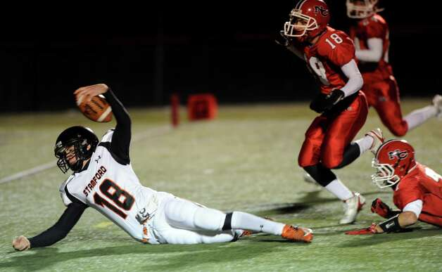 Stamford's Tyler Kane carries the ball as he attempts to reach for a touchdown but fell short during Friday's football game against Stamford at New Canaan High School on November 9, 2012. Photo: Lindsay Niegelberg / Stamford Advocate