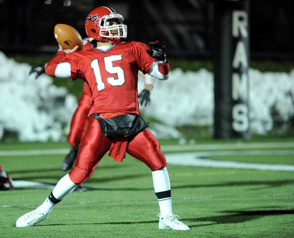 New Canaan's Nick Cascione throws a pass during Friday's football game against Stamford at New Canaan High School on November 9, 2012. Photo: Lindsay Niegelberg / Stamford Advocate