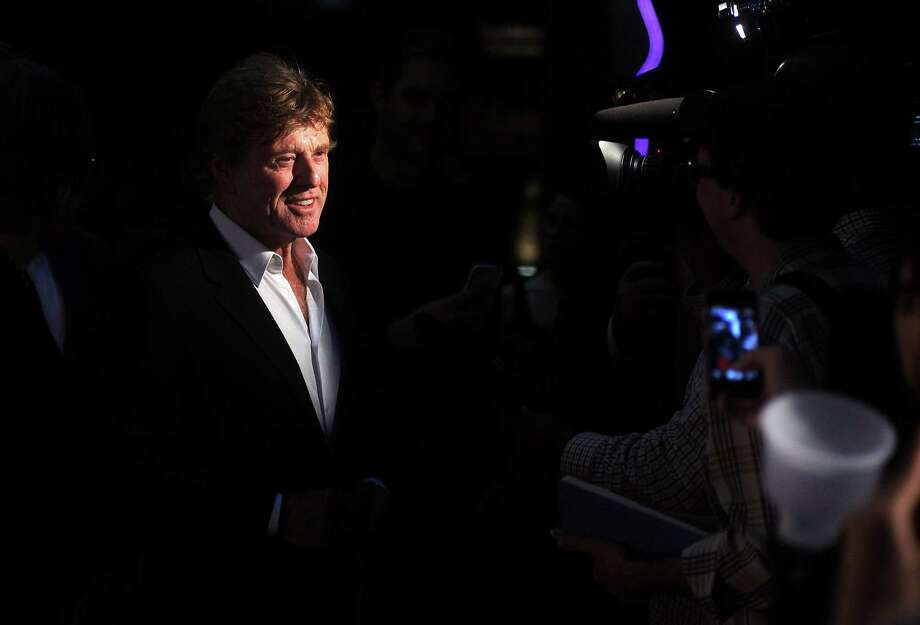 Robert Redford talks to the media before making his entrance to the Cinema Arts Festival event at the Sundance Cinemas downtown Friday Nov. 09,2012. Photo: Dave Rossman, For The Houston Chronicle / © 2012 Dave Rossman