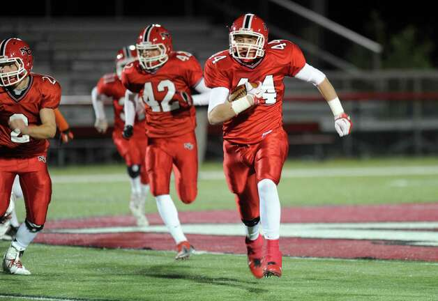 New Canaan's Zach Allen carries the ball during Friday's football game against Stamford at New Canaan High School on November 9, 2012. Photo: Lindsay Niegelberg / Stamford Advocate