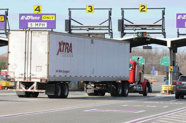 A truck approaches the exit 24 toll booths on Friday, Nov. 9, 2012 in Albany, N.Y. State Thruway Authority could raise truck tolls by 45 percent.  (Lori Van Buren / Times Union) Photo: Lori Van Buren