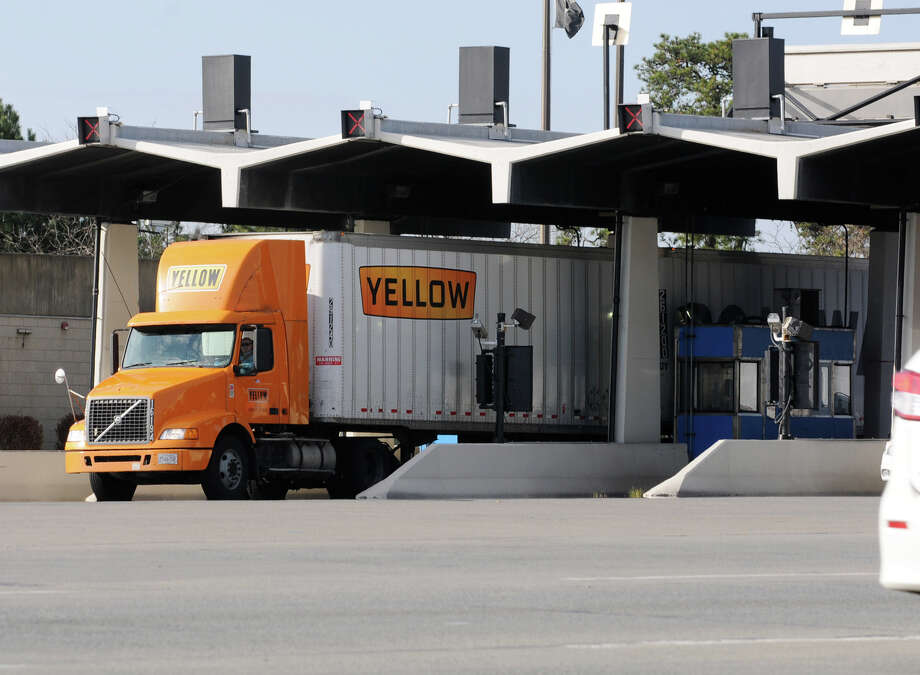 A truck passes through the exit 24 toll booths on Friday, Nov. 9, 2012 in Albany, N.Y. State Thruway Authority could raise truck tolls by 45 percent.  (Lori Van Buren / Times Union) Photo: Lori Van Buren