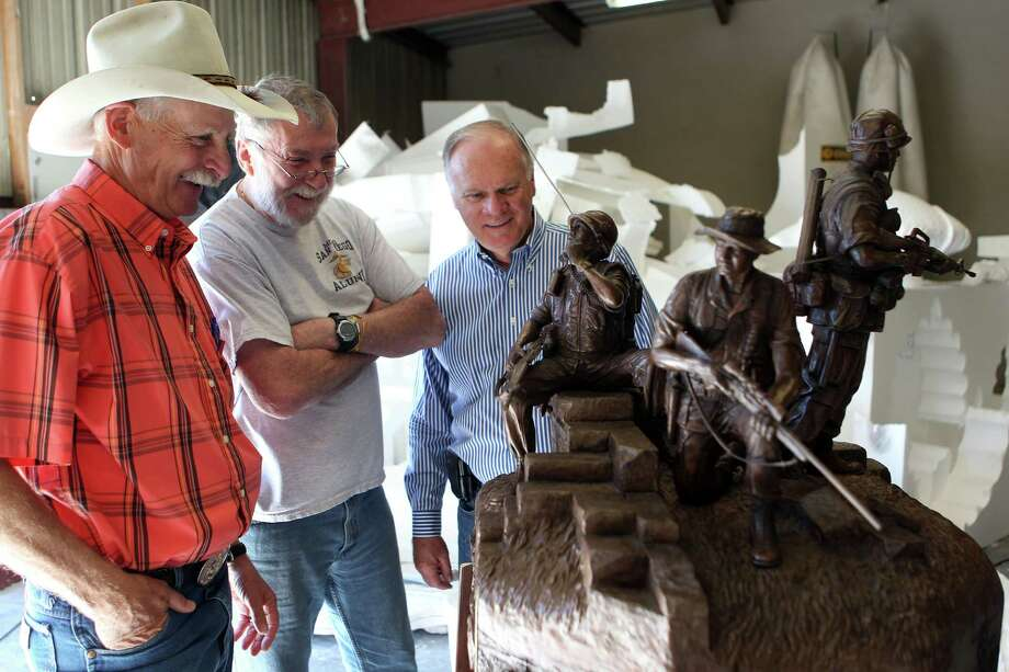 Sculptor Duke Sundt, left, and Vietnam veterans, Don Dorsey, 66, center, who was a Marine scout sniper and Richard McBride, 67, a former infantryman in the U.S. Army, look at the maquette of the future Texas Capitol Vietnam Veterans Monument at the Deep in the Heart Art Foundry  Wednesday, Nov. 7, 2012, in Bastrop. 