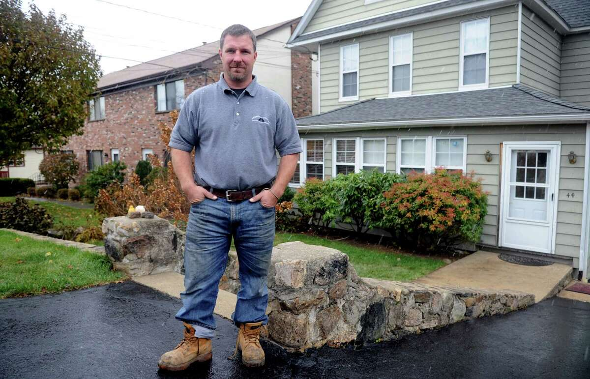 Bruce Vetti poses for a photo outside his Stamford, Conn., home on Wednesday, November 7, 2012. Vetti shared his generator with his neighbor during their power outage due to Superstorm Sandy.